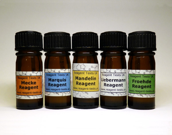 Small medical bottles that contain drug testing reagent testing.